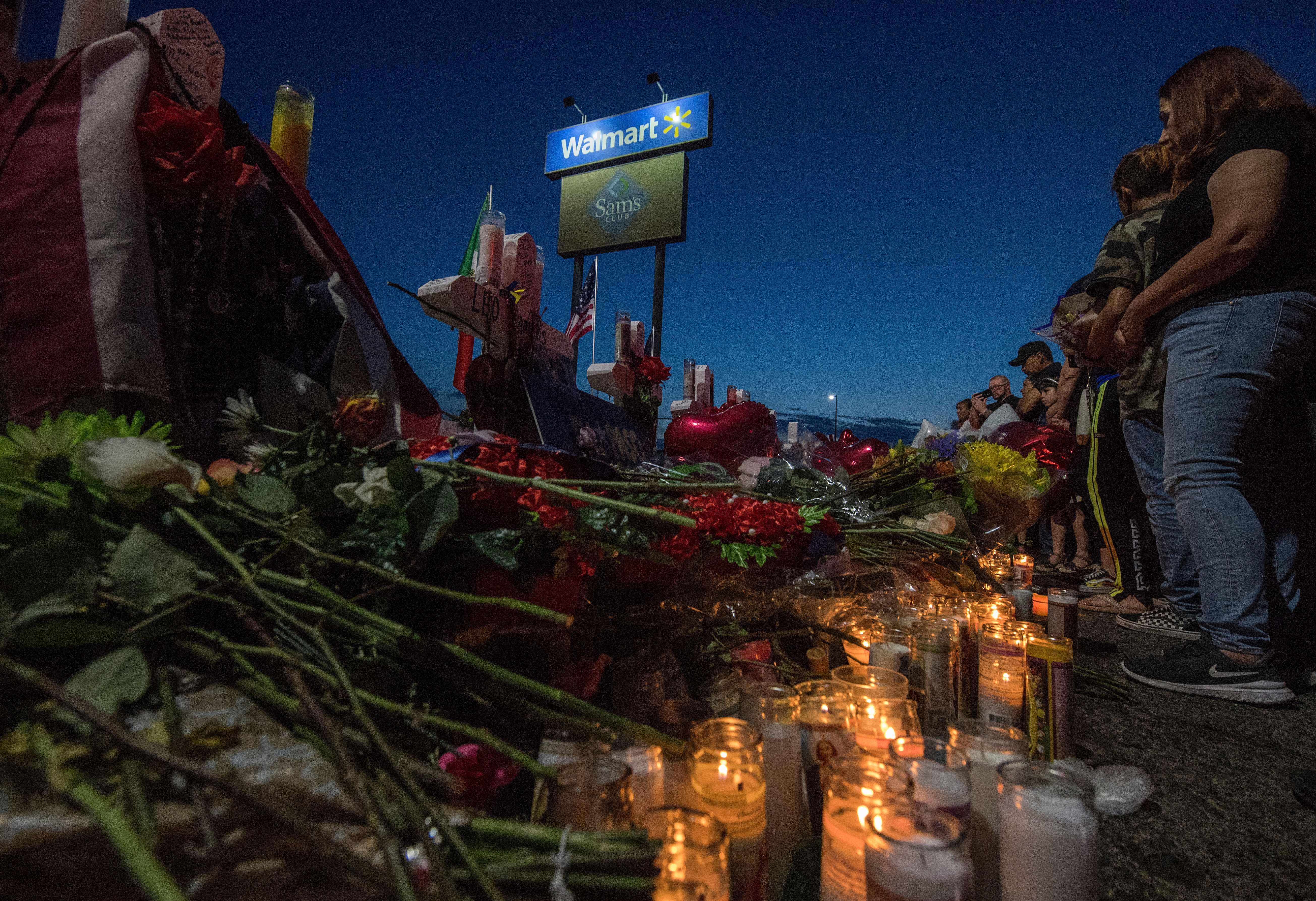 People pay their respects at a memorial for victims of the shooting that left a total of 22 people dead at a Walmart in El Paso, Texas, on Aug. 6, 2019.