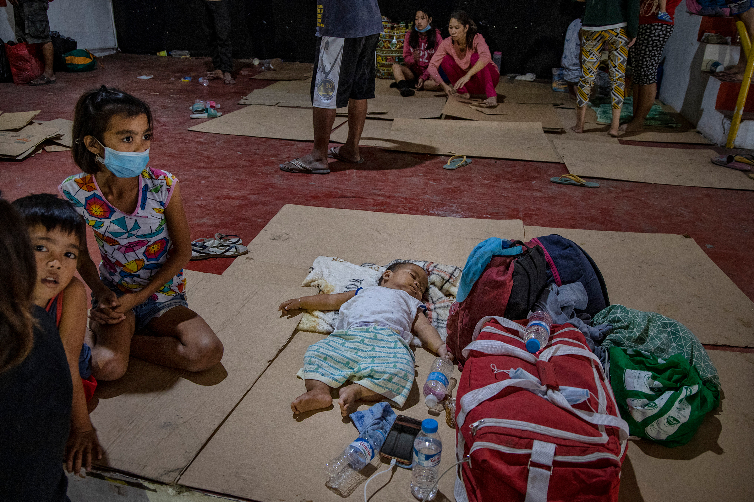 Residents who fled Taal's eruption at an evacuation center in Santo Thomas on Jan. 13.