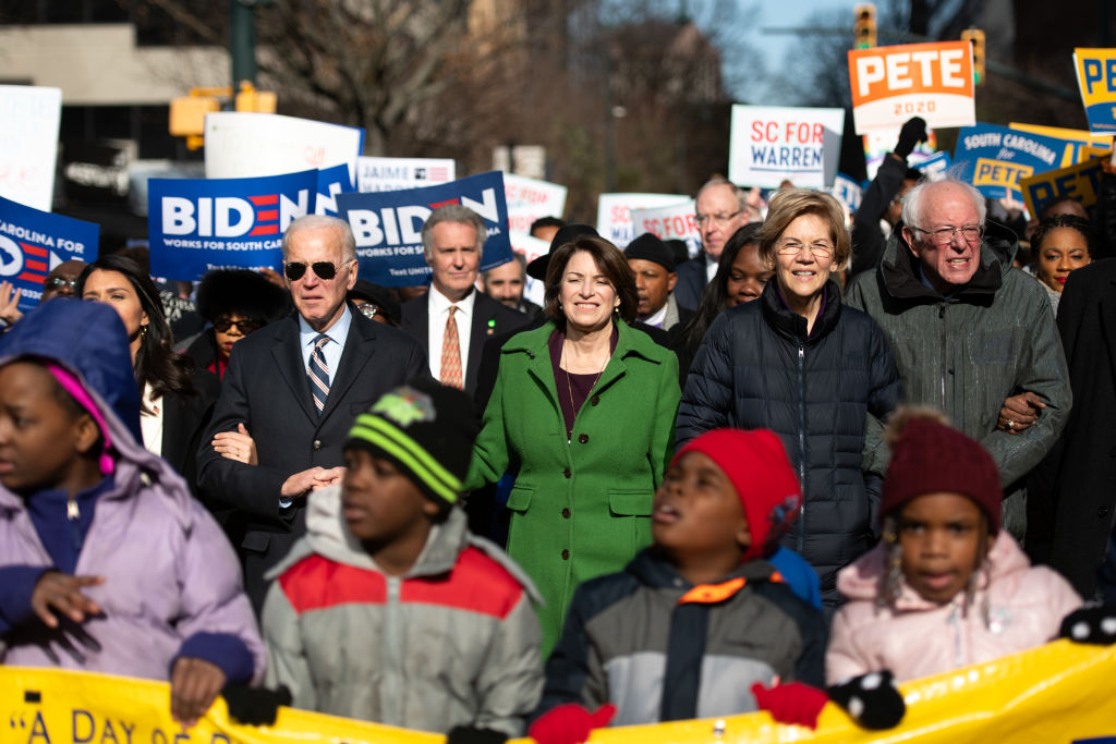 COLUMBIA, SC - JANUARY 20: Democratic presidential candidates, former Vice President Joe Biden, left, Sen. Amy Klobuchar (D-MN), Sen. Elizabeth Warren (D-MA), and Sen. Bernie Sanders (I-VT), right, march down Main St. to the King Day at the Dome event on January 20, 2020 in Columbia, South Carolina. The event, first held in 2000 in opposition to the display of the Confederate battle flag at the statehouse, attracted more than a handful of Democratic presidential candidates to the early primary state. (Photo by Sean Rayford/Getty Images)