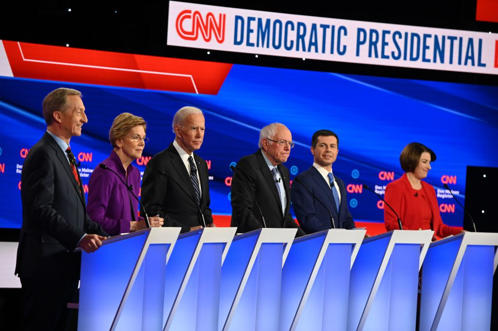 Billionaire-philanthropist Tom Steyer, Massachusetts Sen. Elizabeth Warren, former Vice President Joe Biden, Vermont Sen. Bernie Sanders, former Mayor of South Bend, Ind., Pete Buttigieg and Minnesota Sen. Amy Klobuchar speak during the Democrat debate in Des Moines, Iowa, on Jan. 14, 2020.