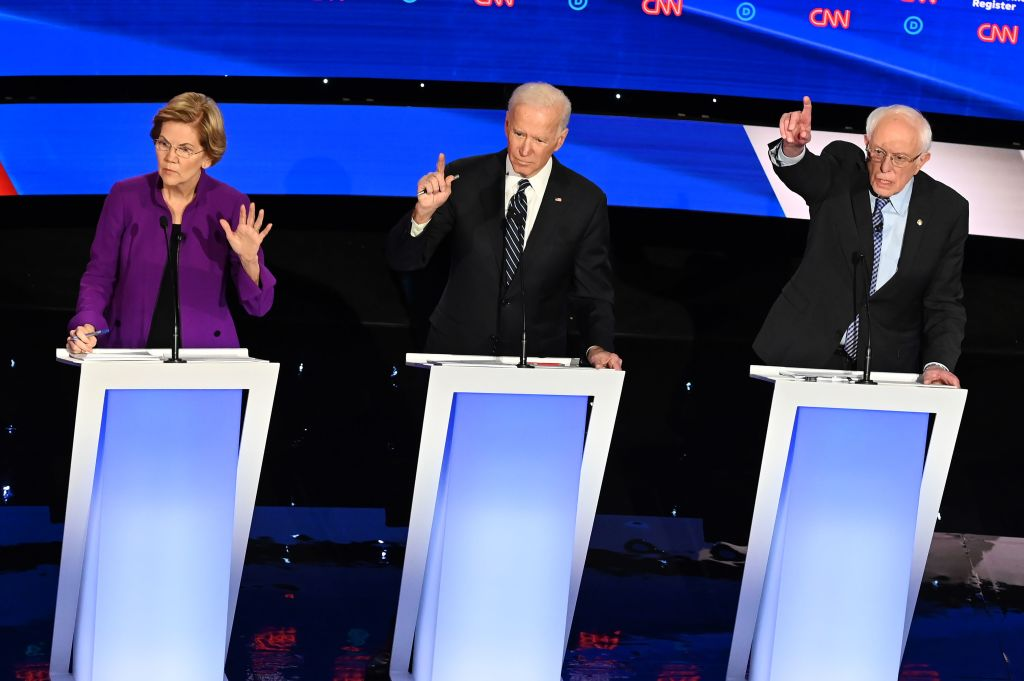 Sen. Elizabeth Warren, former Vice President Joe Biden and Vermont Sen. Bernie Sanders in the seventh Democratic primary debate of the 2020 presidential campaign in Des Moines, Iowa, on Jan. 14, 2020.