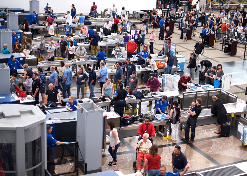 Lines of airplane passengers proceed through the TSA security checkpoint at Denver International Airport in Denver, Colorado on Aug. 30, 2019.