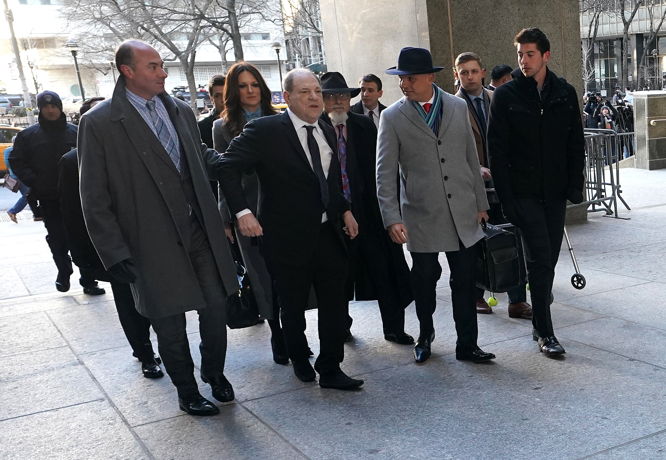 Harvey Weinstein (C) arrives at the Manhattan Criminal Court, on Jan. 22, 2020 for opening arguments in his rape trial in New York City.