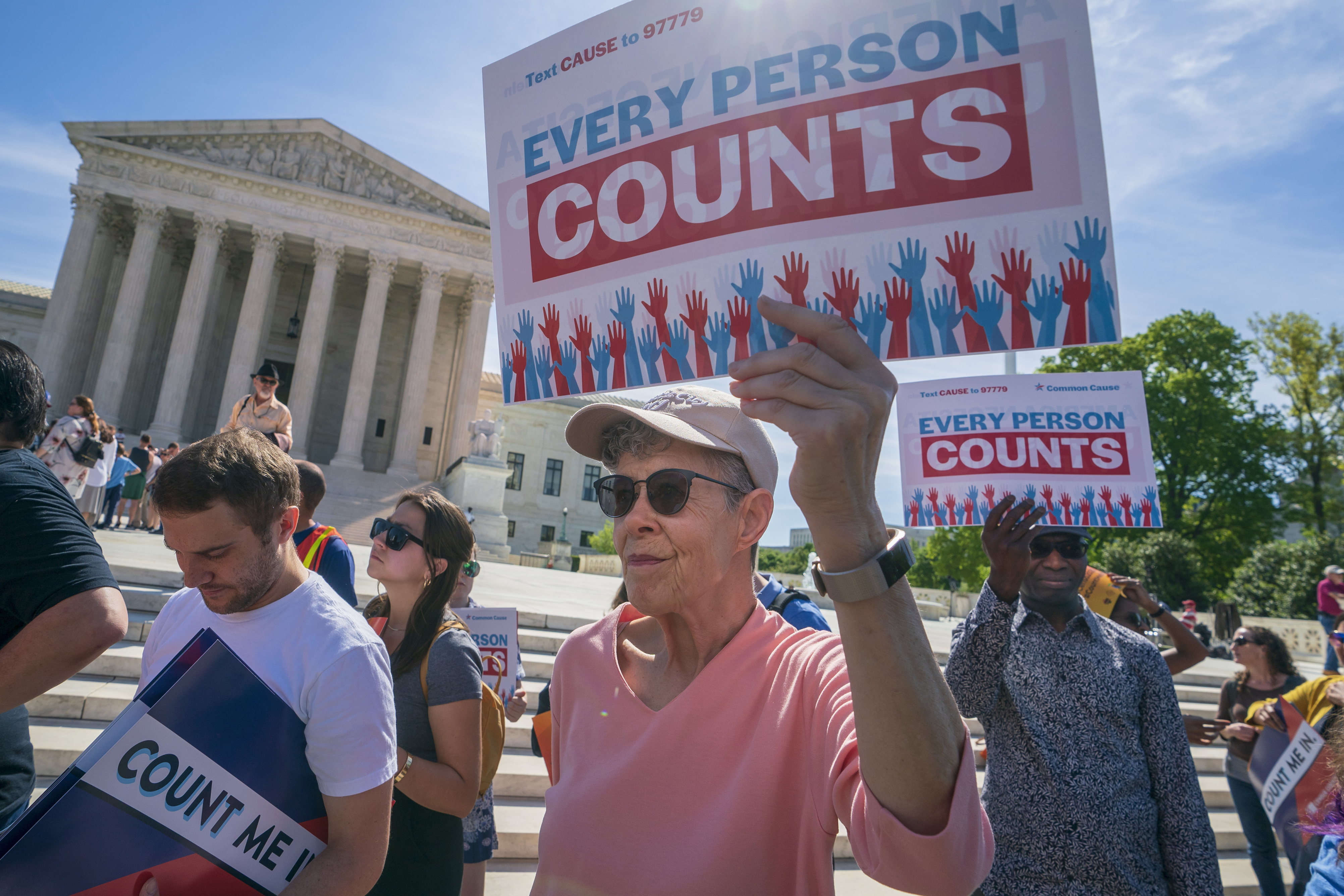 Immigration activists rally outside the Supreme Court as the justices hear arguments over the Trump administration's plan to ask about citizenship on the 2020 census, in Washington D.C., on April 23, 2019.