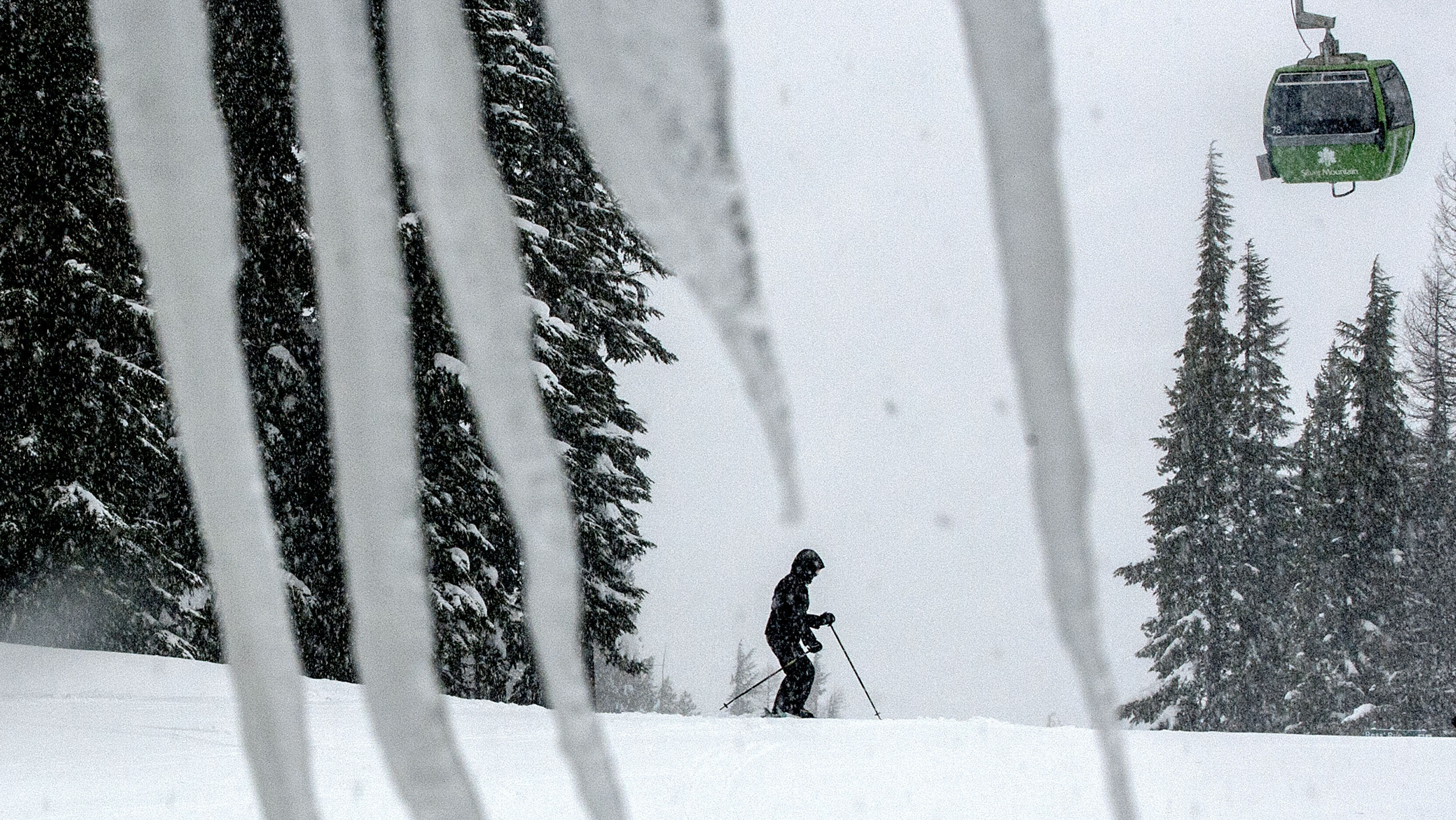 In this Feb. 25, 2013 file photo, a skier takes advantage of the snowy conditions at Silver Mountain in Kellogg, Idaho.