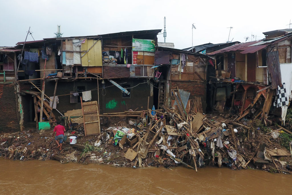 Structures damaged by floods stand along the Ciliwung River in the Mangarai district of Jakarta, Indonesia, on Jan. 4, 2020.