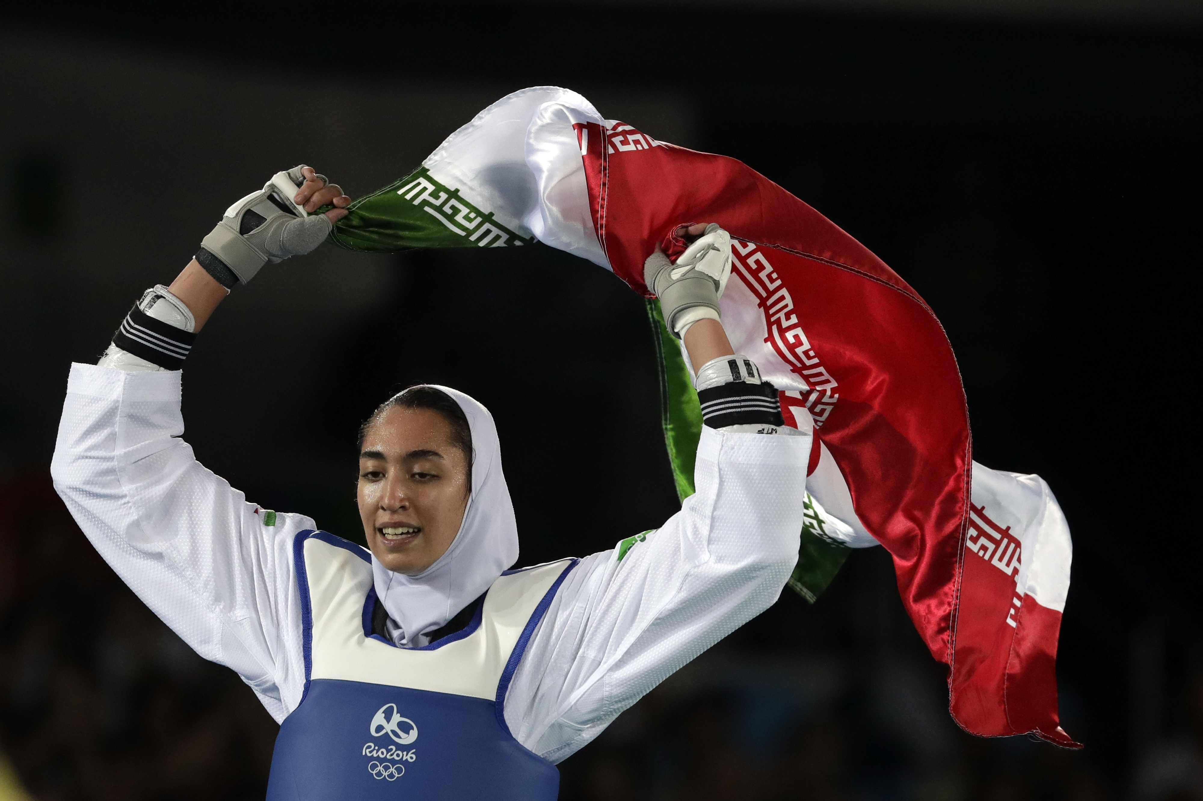 Kimia Alizadeh Zenoorin of Iran celebrates after winning the bronze medal in a women's Taekwondo 57-kg competition at the 2016 Summer Olympics in Rio de Janeiro, Brazil, on Aug. 18, 2016.