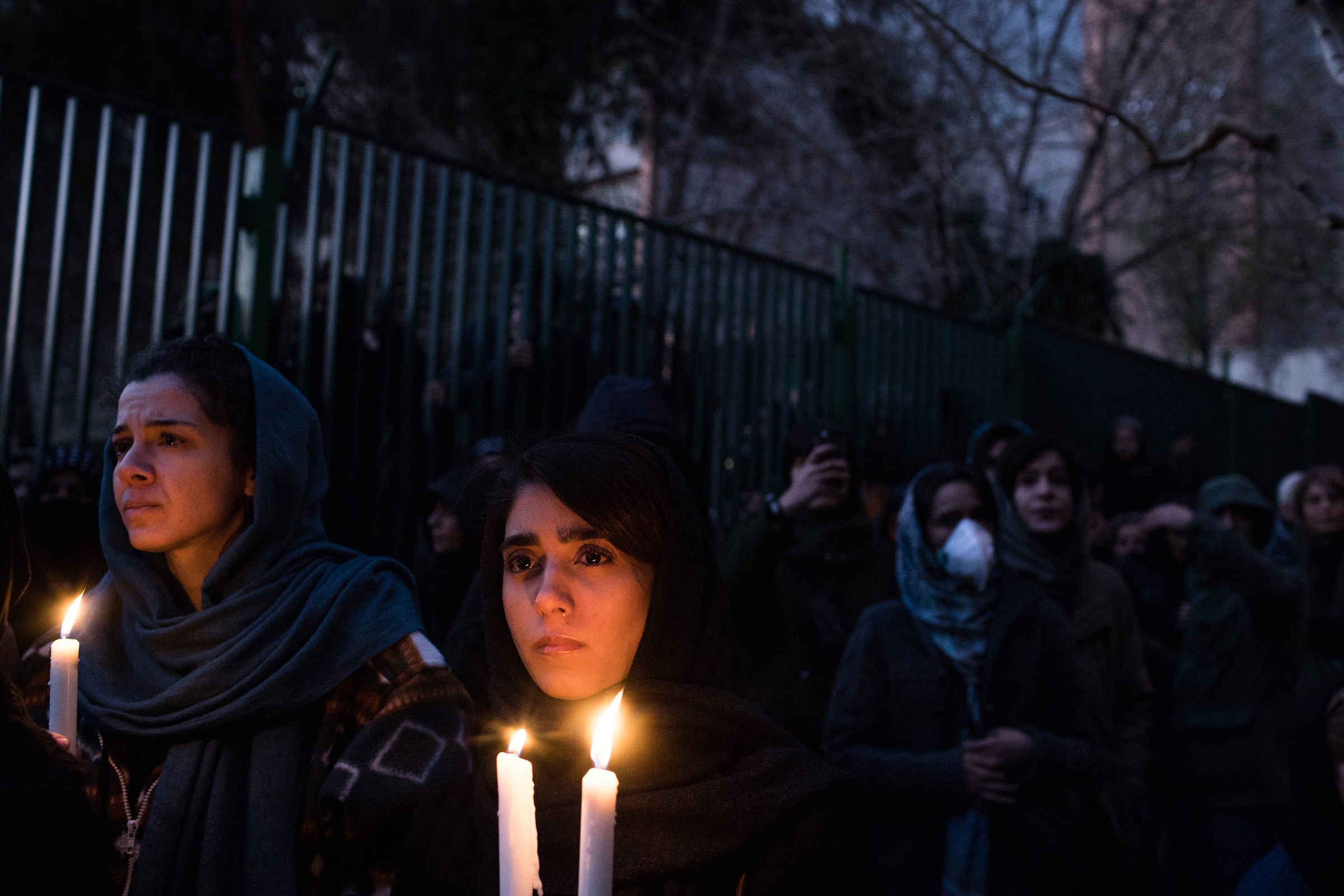 Demonstrators at a vigil in Tehran on Jan.11 mourn victims of a plane crash caused by Iran's military
