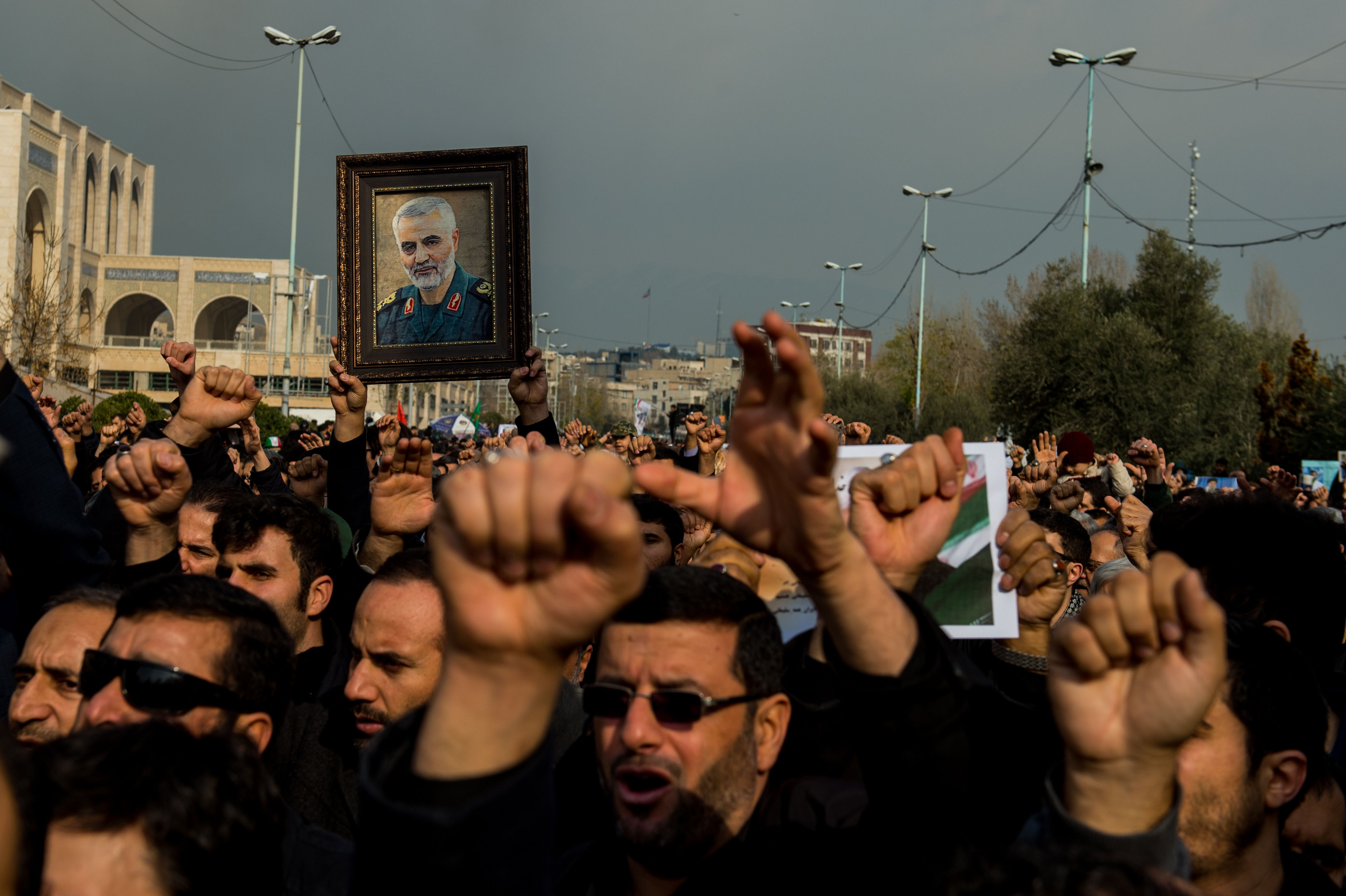 Protesters hold up an image of Qasem Soleimani during a demonstration in Tehran, Iran, following the U.S. airstrike in Iraq which killed him on Jan. 3, 2020.