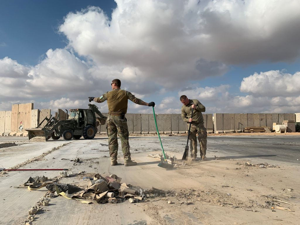 U.S. soldiers clear rubble at Ain al-Asad military airbase in the western Iraqi province of Anbar on Jan. 13, 2020.