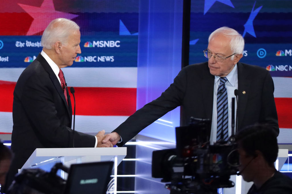 Biden and Sanders shake hands after the Democratic presidential debate at Tyler Perry Studios in Atlanta, Ga., on Nov. 20, 2019.