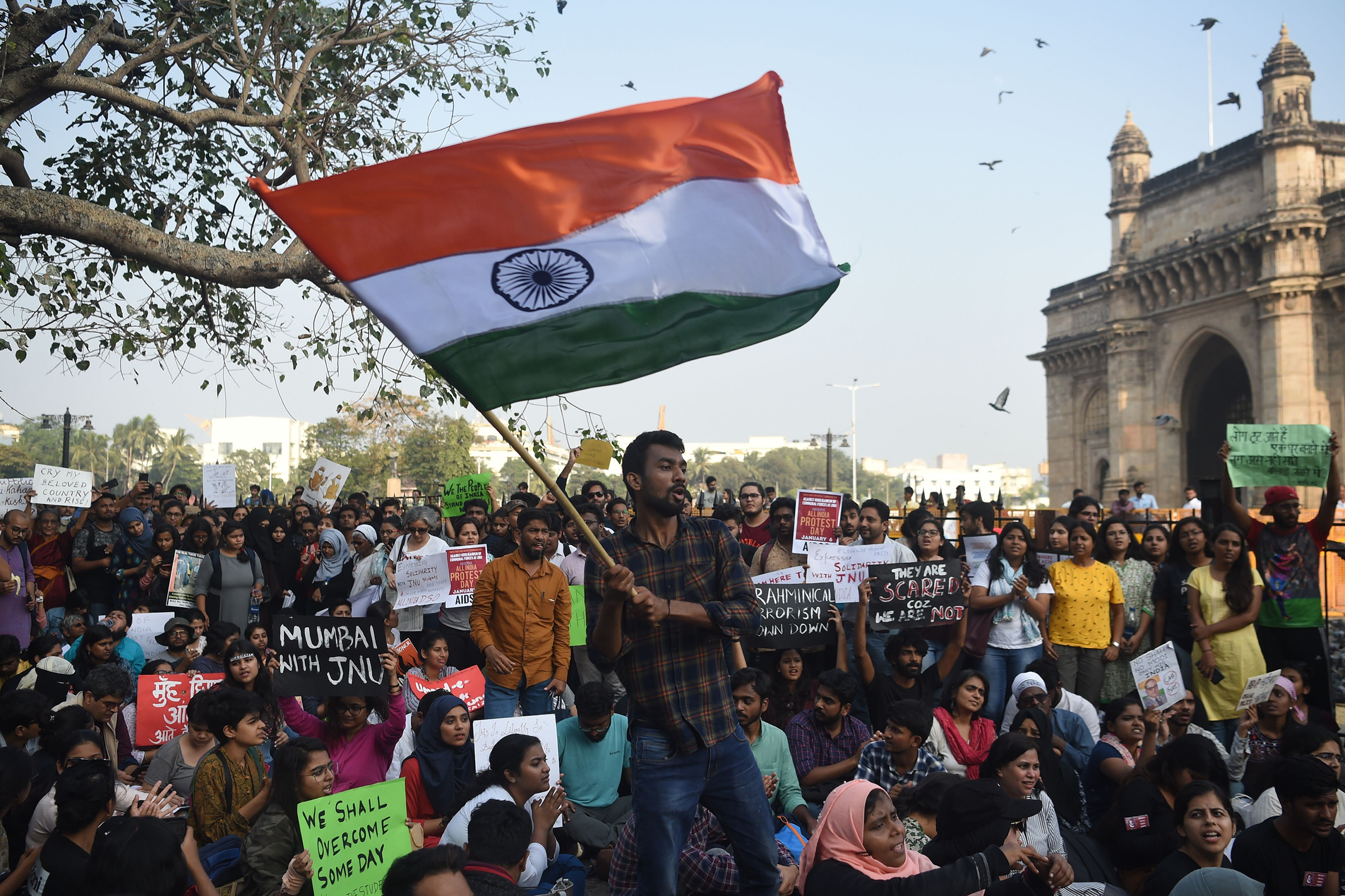 Protesters and students in Mumbai shout slogans and hold Indian flags as they protest against the violent clashes at the Jawaharlal Nehru University (JNU) campus in New Delhi a day before, on Jan. 6, 2020.