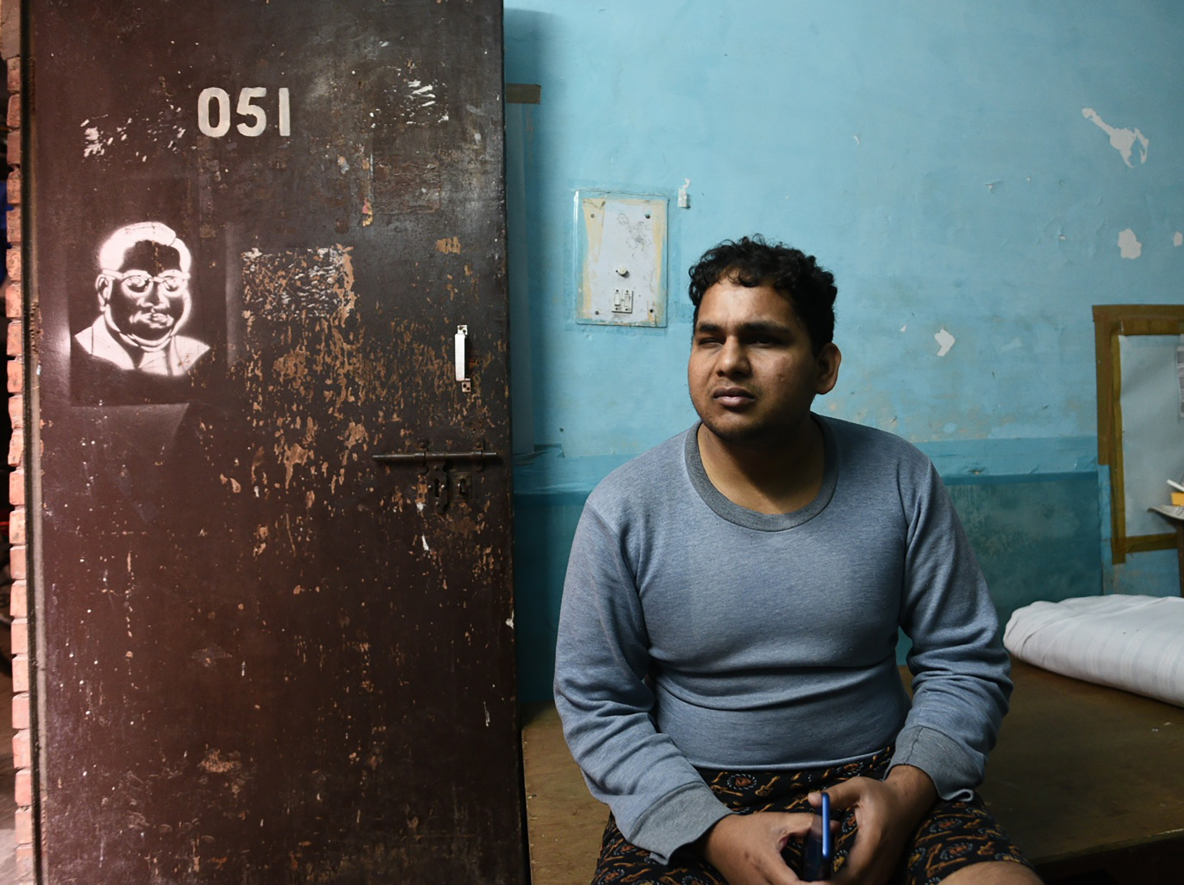 Suryaprakash, a blind research scholar pursuing an MPhil in Sanskrit, is seen sitting in his room at Sabarmati Hostel, Jawaharlal Nehru University (JNU), on Jan. 6, 2020 in New Delhi, India. He was also beaten up the day before during violence inside the campus.