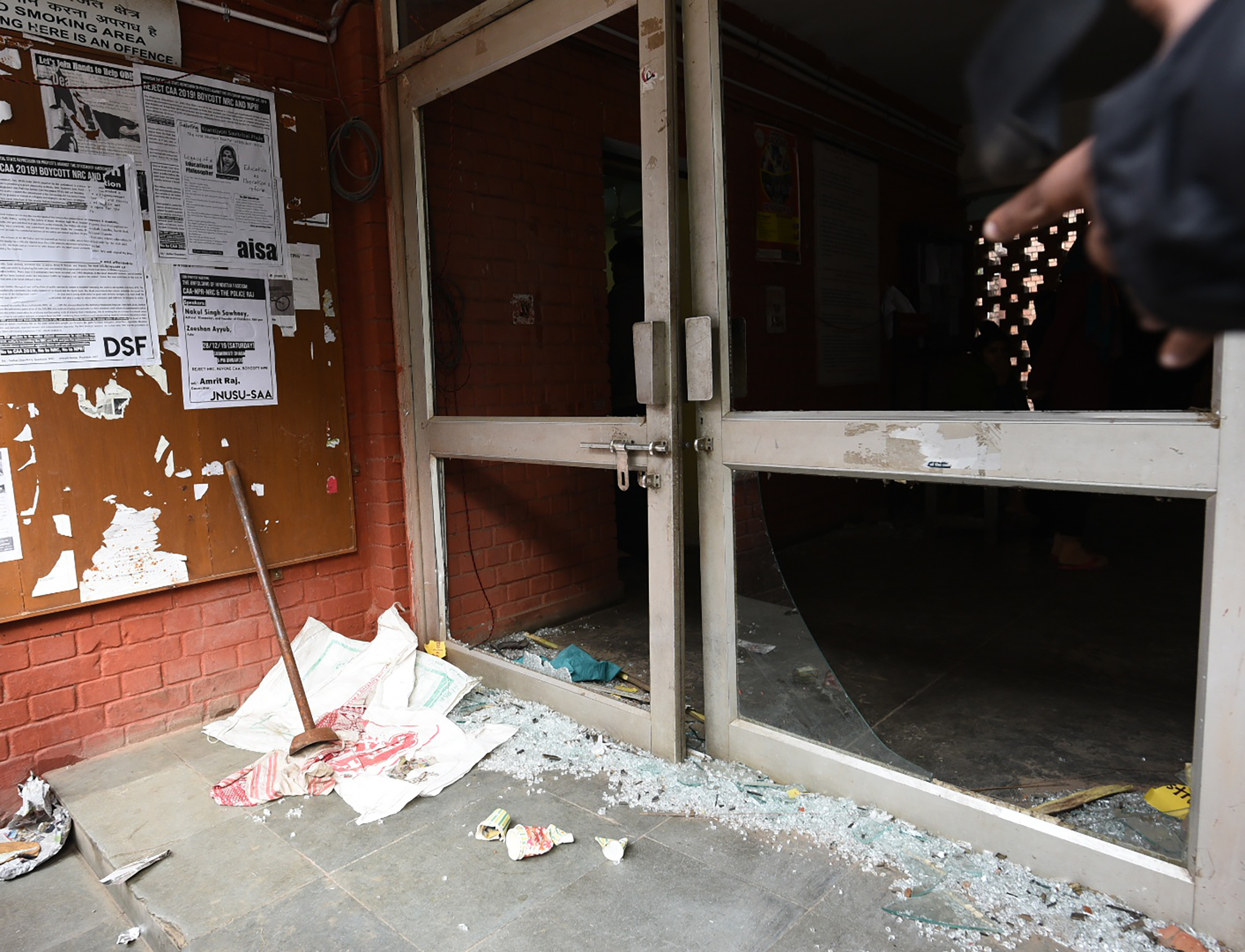 Shards of glass are seen in the premises of Sabarmati Hostel, at Jawaharlal Nehru University (JNU), on Jan. 6, 2020 in New Delhi, India.