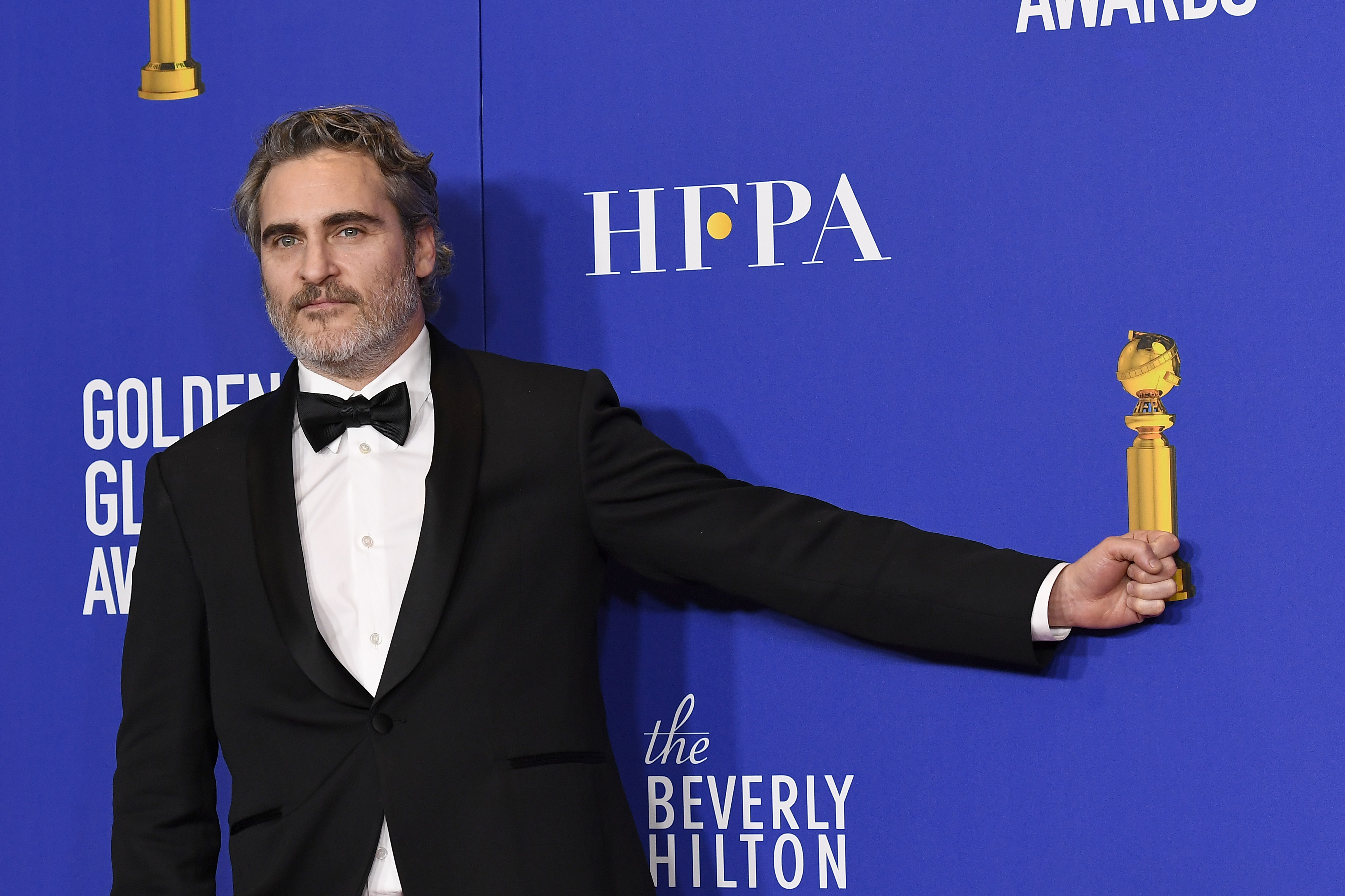 Joaquin Phoenix poses in the press room after winning the award for Best Performance by an Actor in a Motion Picture - Drama at the 77th Annual Golden Globe Awards.