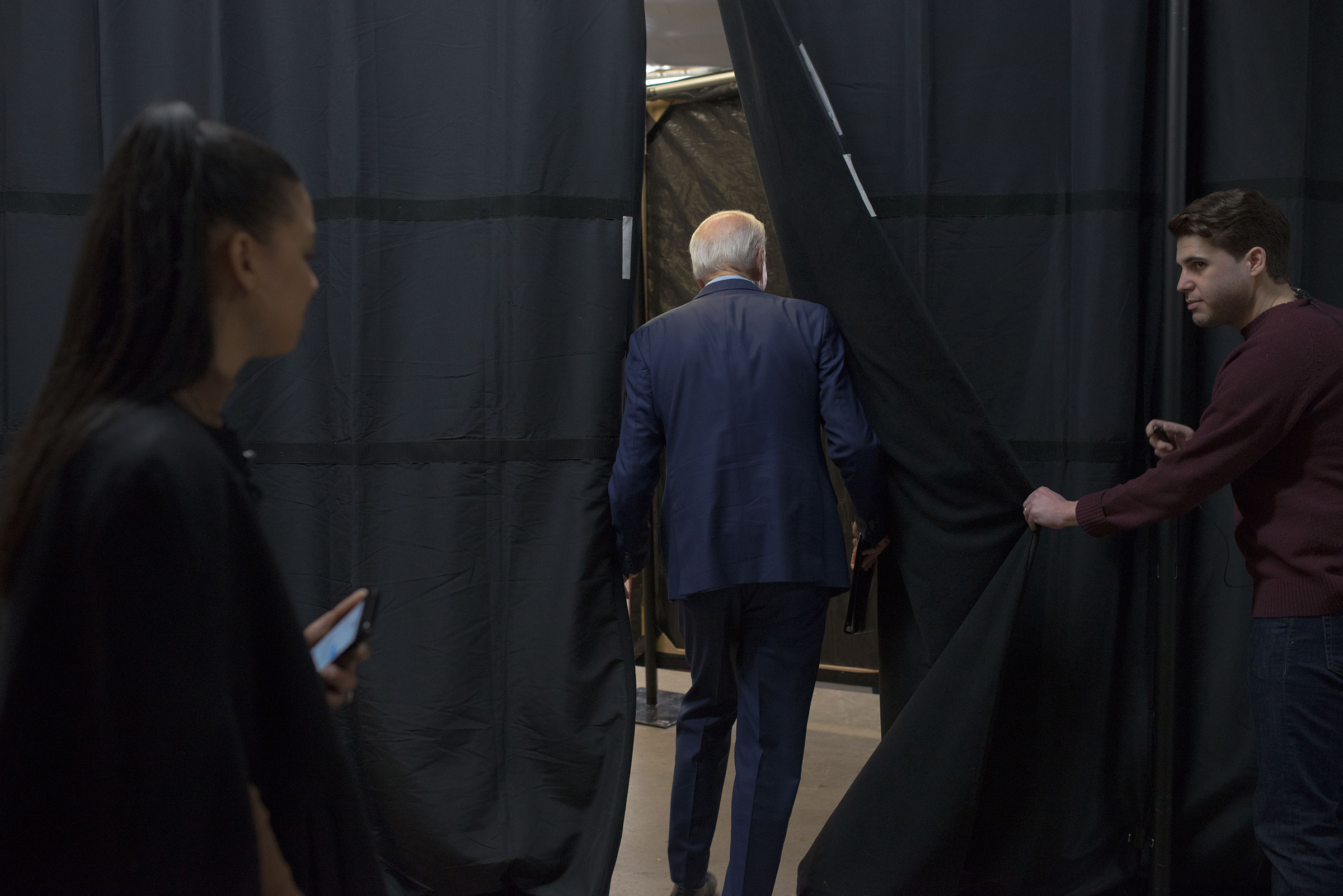 Biden waits backstage before his campaign event in Mason City