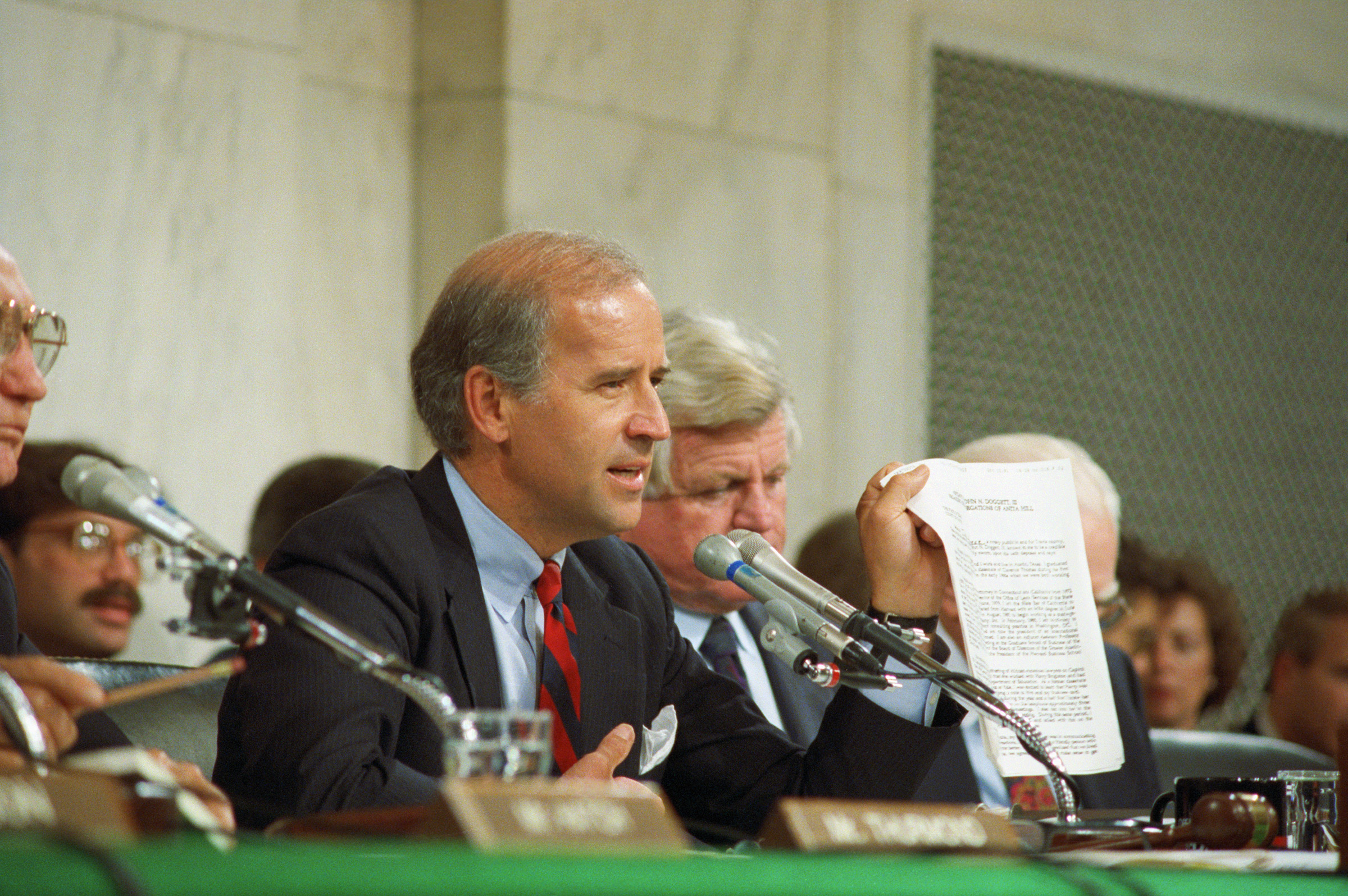 After Anita Hill accuses Clarence Thomas of sexual harassment, Biden presides over an all-white-male panel in the Senate in 1991