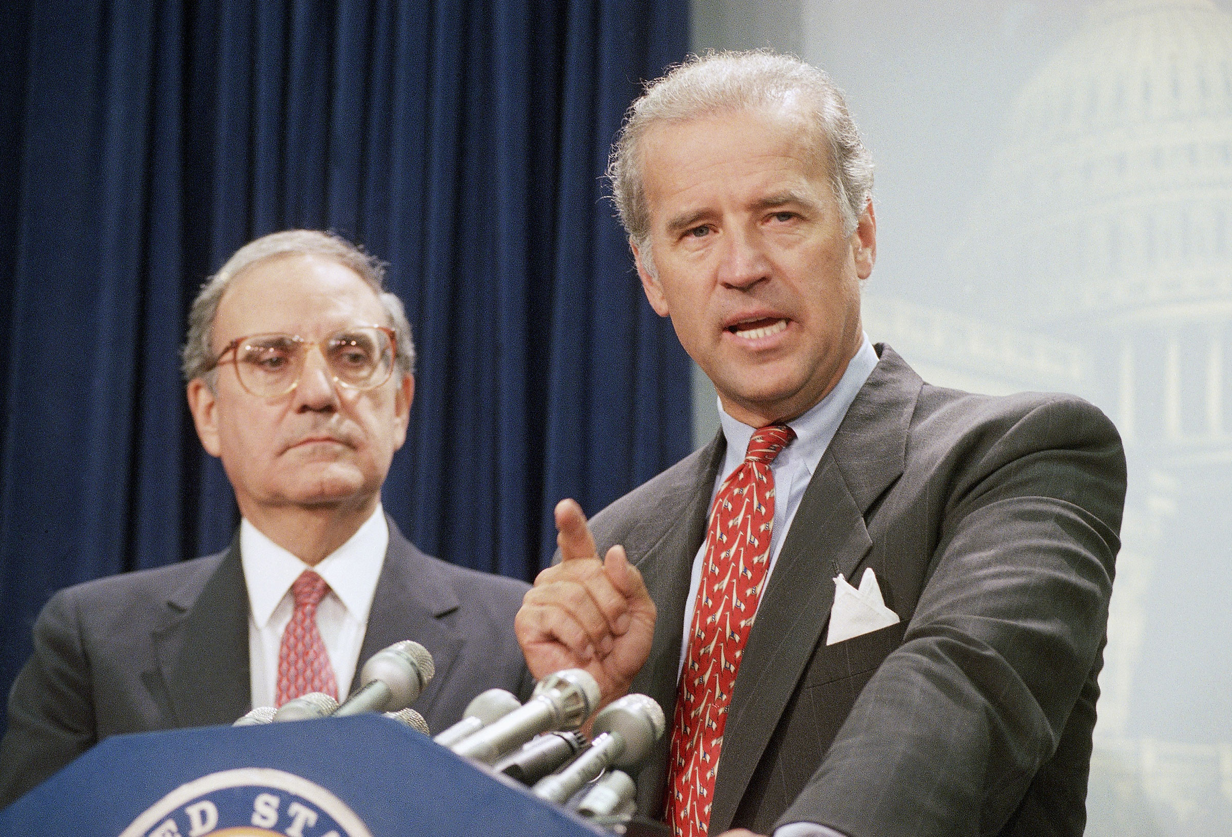 Biden helps write the controversial crime bill signed by President Clinton in 1994