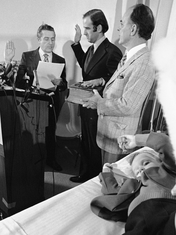 Mourning his wife and daughter, Biden is sworn in at his sons' hospital room in 1973