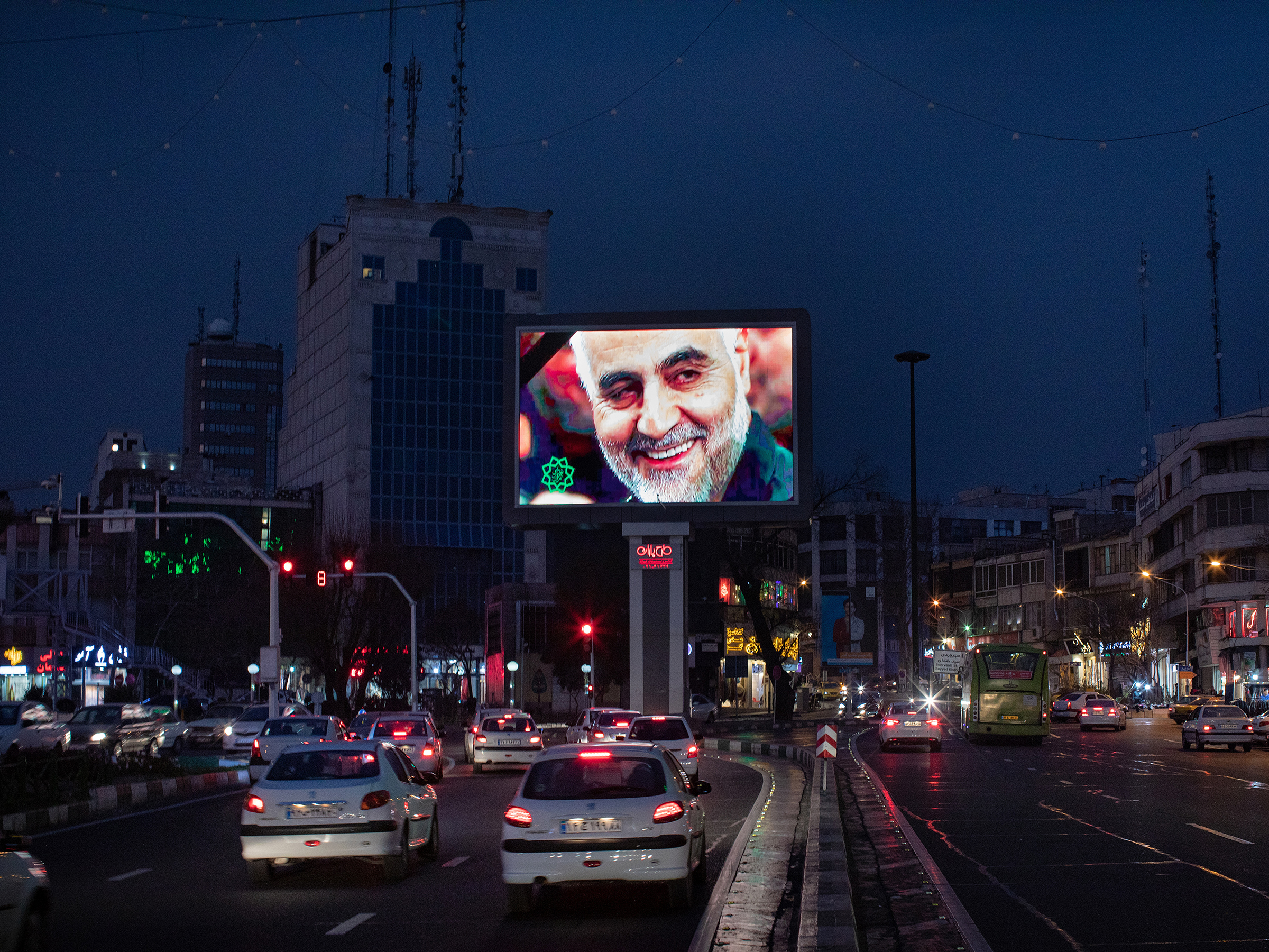 As the evening traffic unfolds in Tehran, a giant digital billboard in Haft-e Tir square displays an image of Maj. Gen. Qasem Soleimani, following his killing in Baghdad, on Jan. 3.