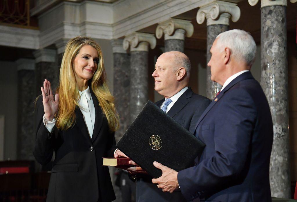 Vice President Mike Pence (R) conducts the ceremonial swearing-in of U.S. Senator Kelly Loeffler (L), R-GA, as her husband husband Jeffrey Sprecher, looks on, in the U.S. Capitol in Washington, D.C. on Jan. 6, 2020.