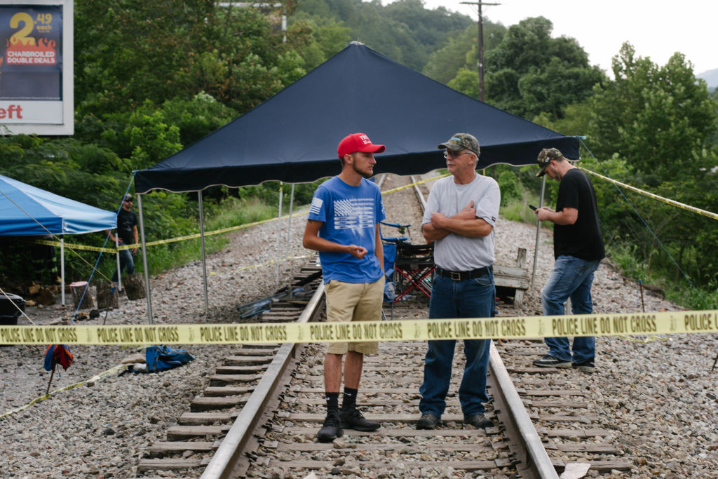 Miners stand on train tracks in Cumberland, Kentucky, during a previous labor action in August 2019.