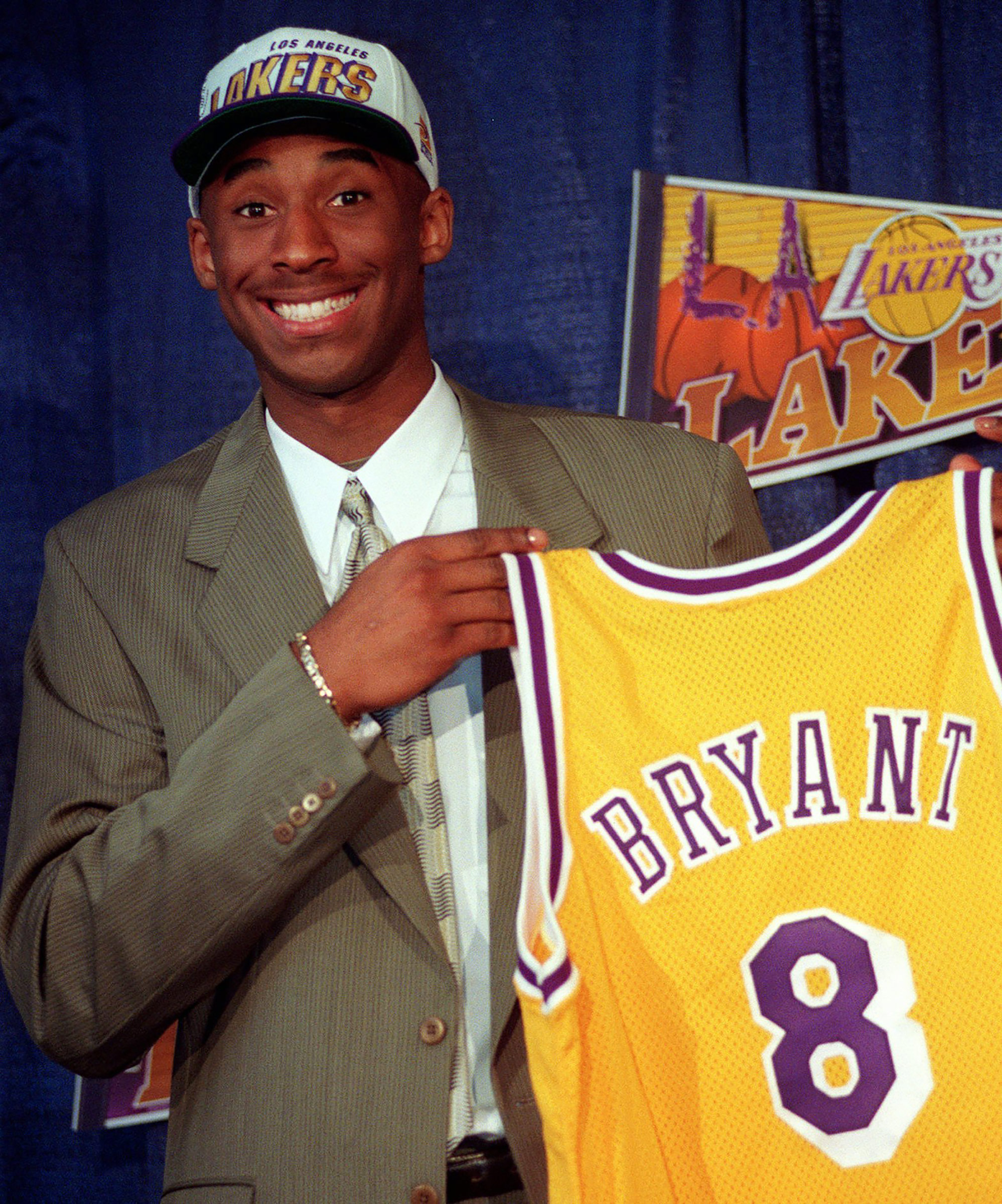 Kobe Bryant, 17, holds his Los Angeles Lakers jersey during a news conference, on July 12, 1996.