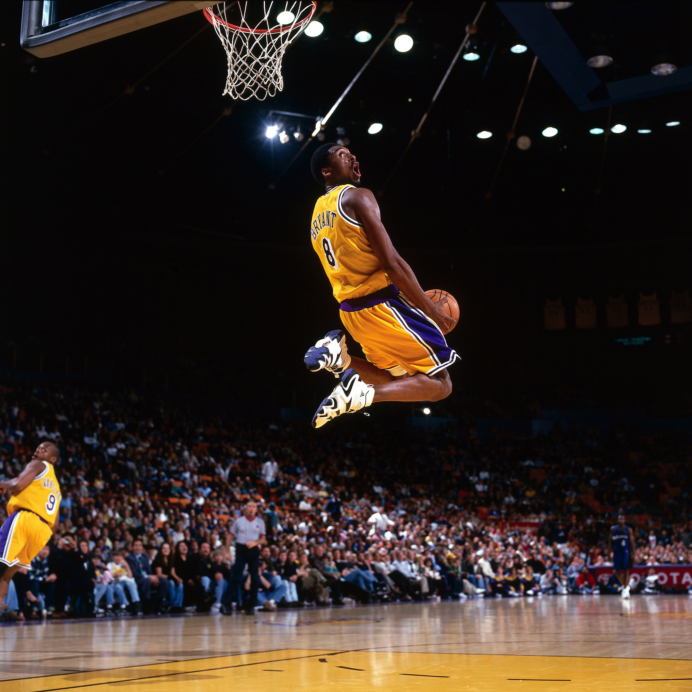 Bryant's aerial displays were among the game's most thrilling ever; here, a reverse slam in a 1998 home game