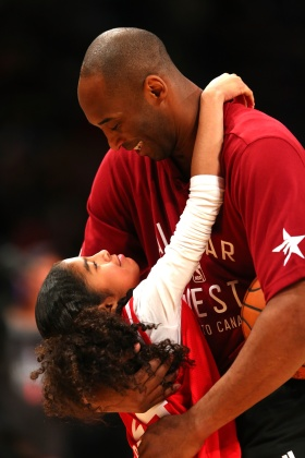 Bryant holds his daughter Gianna, then 9, before the 2016 NBA All-Star Game in Toronto