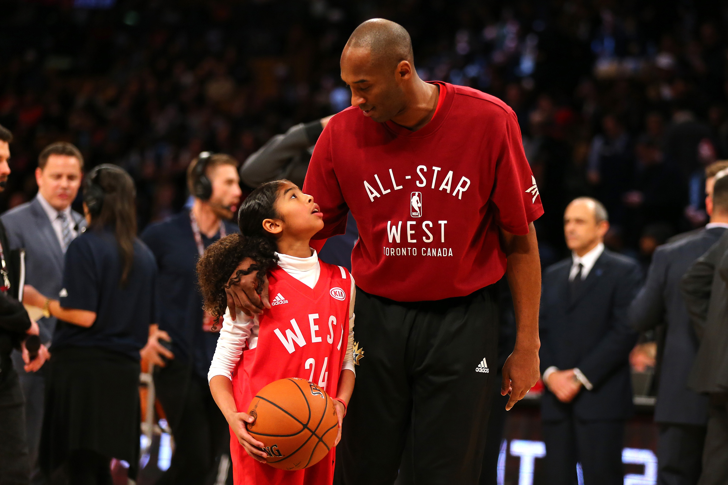 Kobe Bryant warms up with daughter Gianna Bryant during the NBA All-Star Game on Feb. 14, 2016.