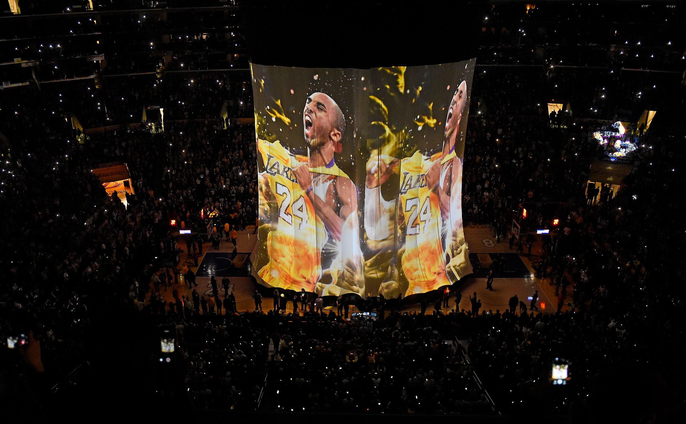 Los Angeles Lakers forward Kobe Bryant's image is displayed to the crowd during a ceremony before Bryant's last game on April 13, 2016.