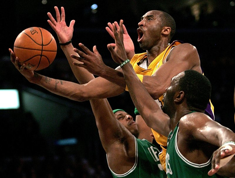Kobe Bryant goes up for a shot between the Boston Celtics' Paul Pierce and Al Jefferson during an NBA basketball game in Los Angeles on Feb. 23, 2006.