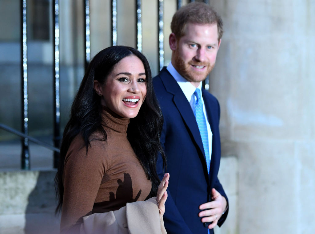Britain's Prince Harry, Duke of Sussex and Meghan, Duchess of Sussex reacts as they leave after her visit to Canada House in London on Tuesday.
