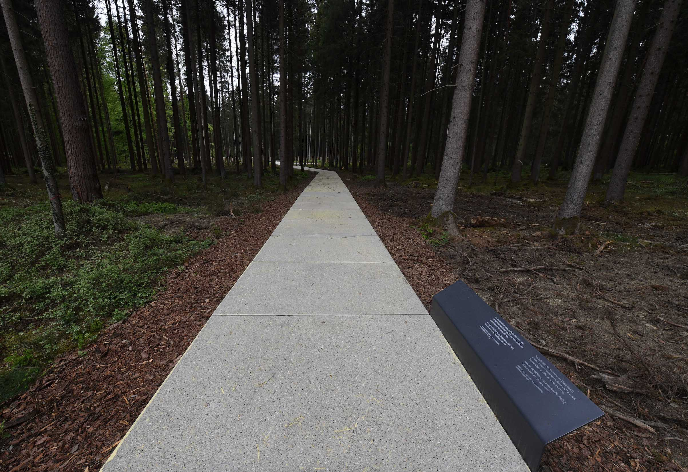 Concrete slabs lead to the places of the former mass grave of the former concentration camp Muehldorf at the Muehldorfer Hart, southern Germany, pictured on April 26, 2018.