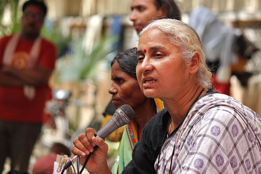Activist Medha Patekar and supporters of Narmada Bachao Andolan staging a protest against raising height of Narmada dam at Jantar Mantar on June 25, 2014 in New Delhi, India.