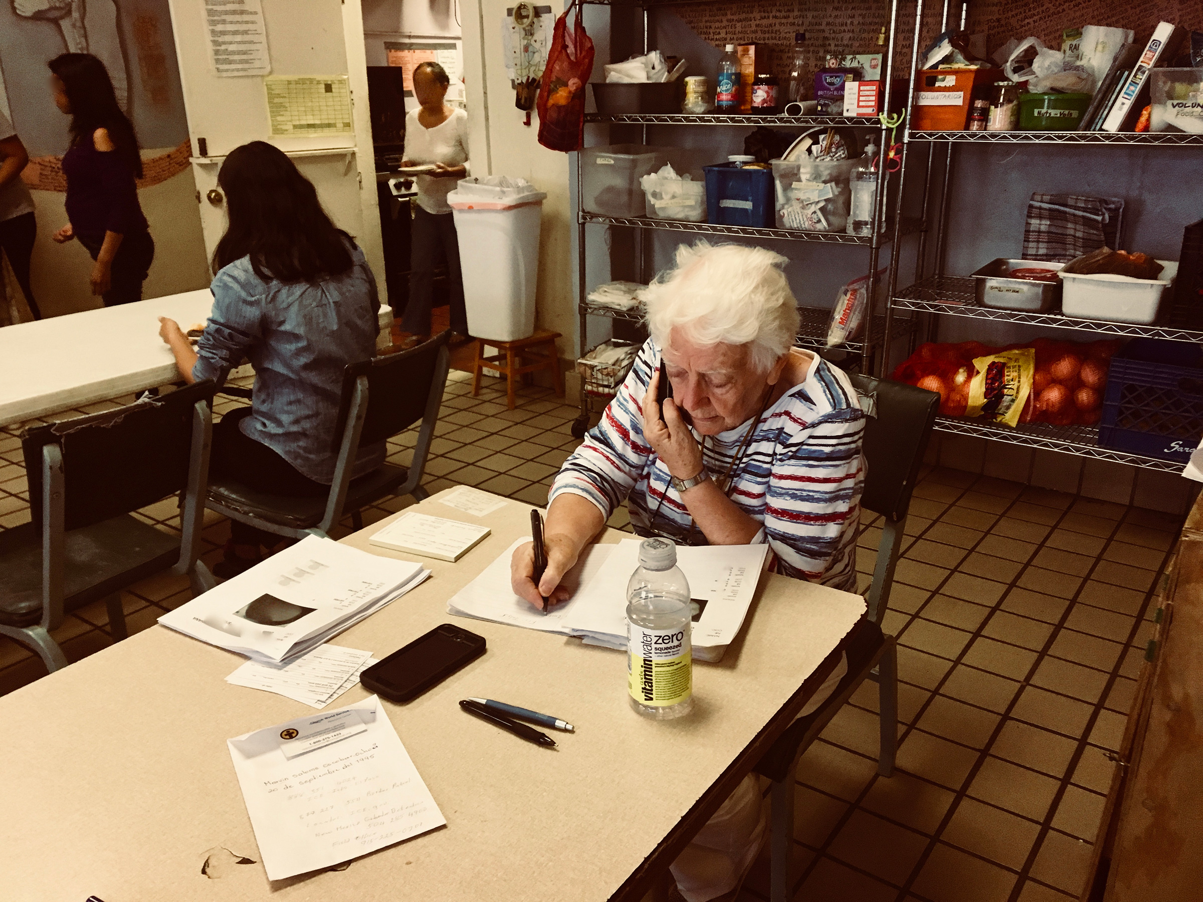 Sister Caroline Sweeney, a volunteer, makes calls to the families of recent arrivals in Casa Vides in El Paso, Texas in August 2019.