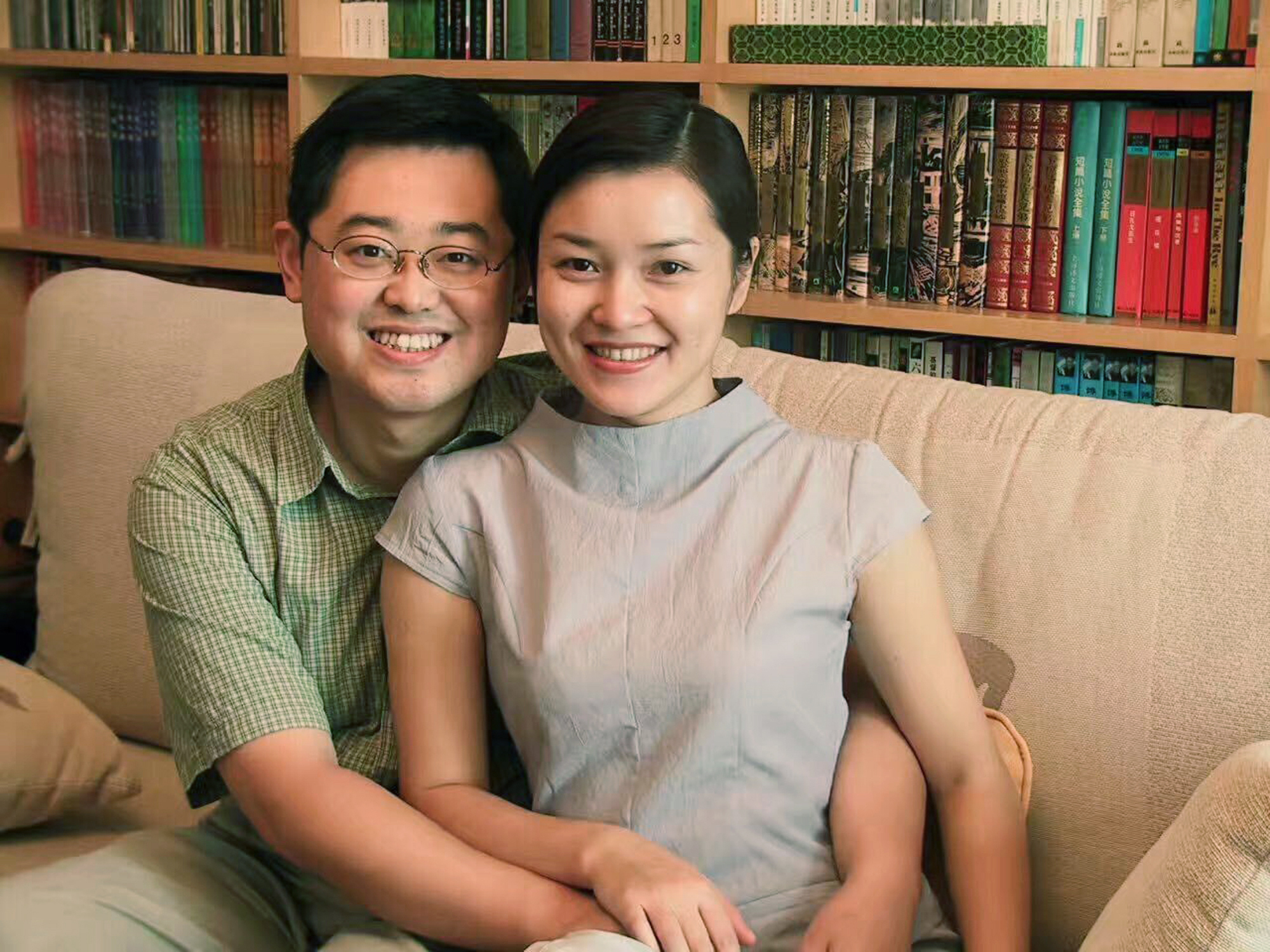 In this 2000 photo provided by ChinaAid, pastor Wang Yi, left, poses with his wife Jiang Rong at the study room of their home in Chengdu, China.