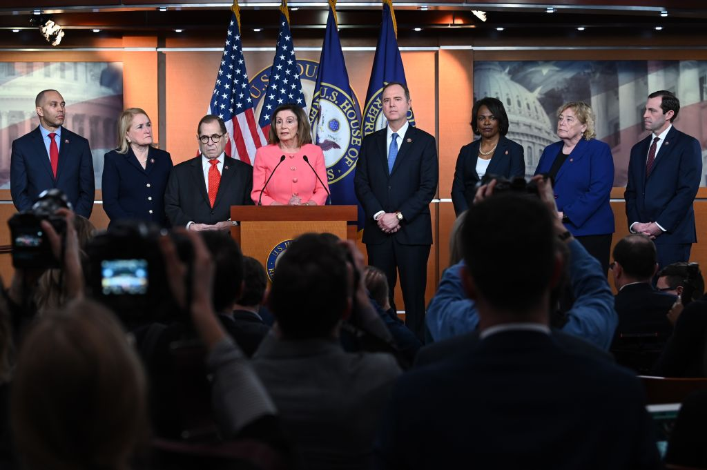 Speaker of the House Nancy Pelosi announces impeachment managers for the articles of impeachment against US President Donald Trump on Capitol Hill January 15, 2020, in Washington, DC, next to Judiciary Committee Chairman Jerry Nadler and Adam Schiff, the House Democrat who led the Trump investigation.