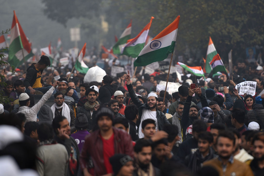 People hold national flags during a protest against India's new citizenship law at Jamia Millia Islamia University on Dec. 20, 2019 in New Delhi, India.