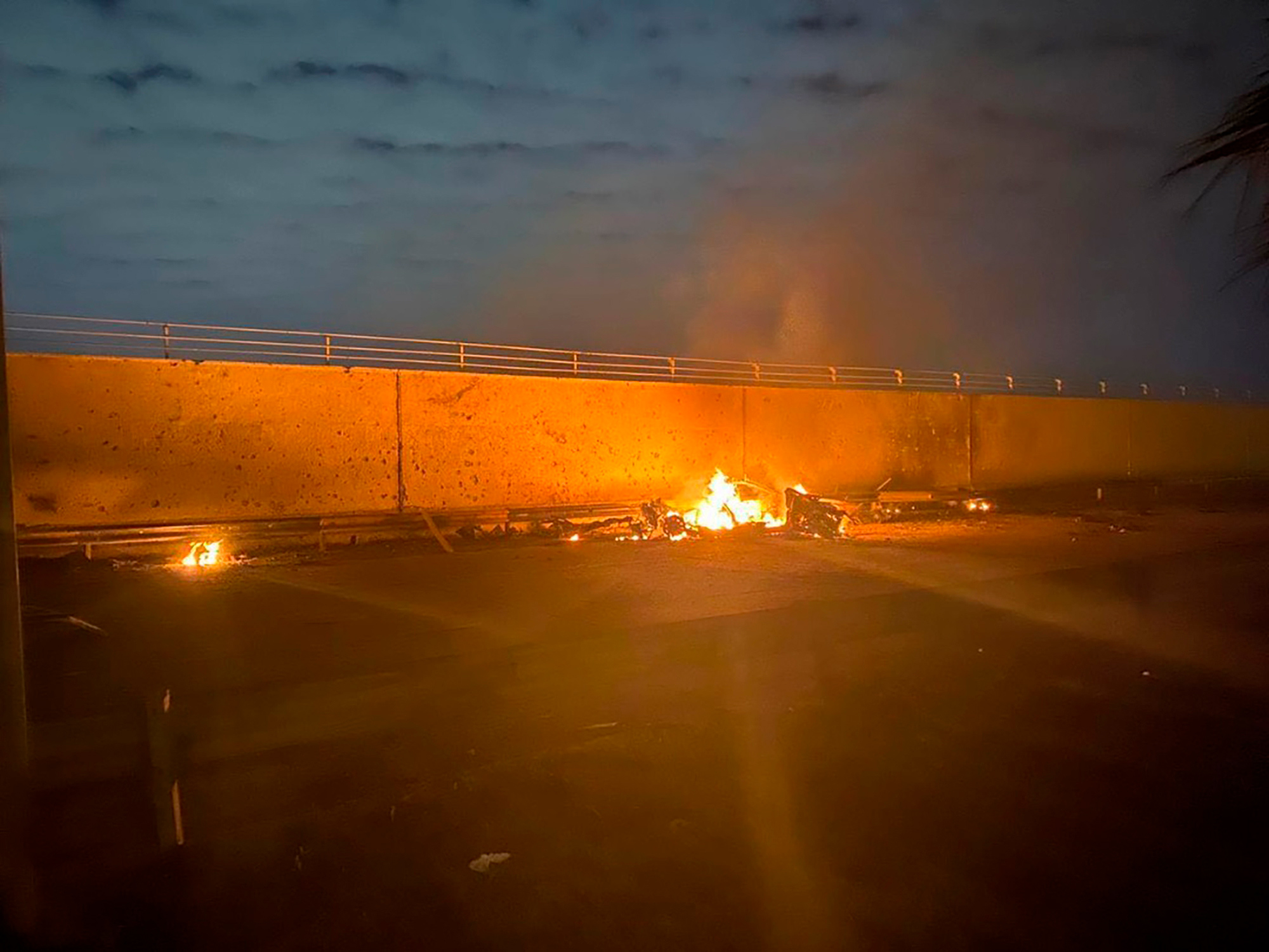 A burning vehicle following an airstrike at Baghdad International Airport on Jan. 3, 2020. The Pentagon said the U.S. military killed Gen. Qasem Soleimani, the head of Iran's elite Quds Force, at the direction of President Trump.