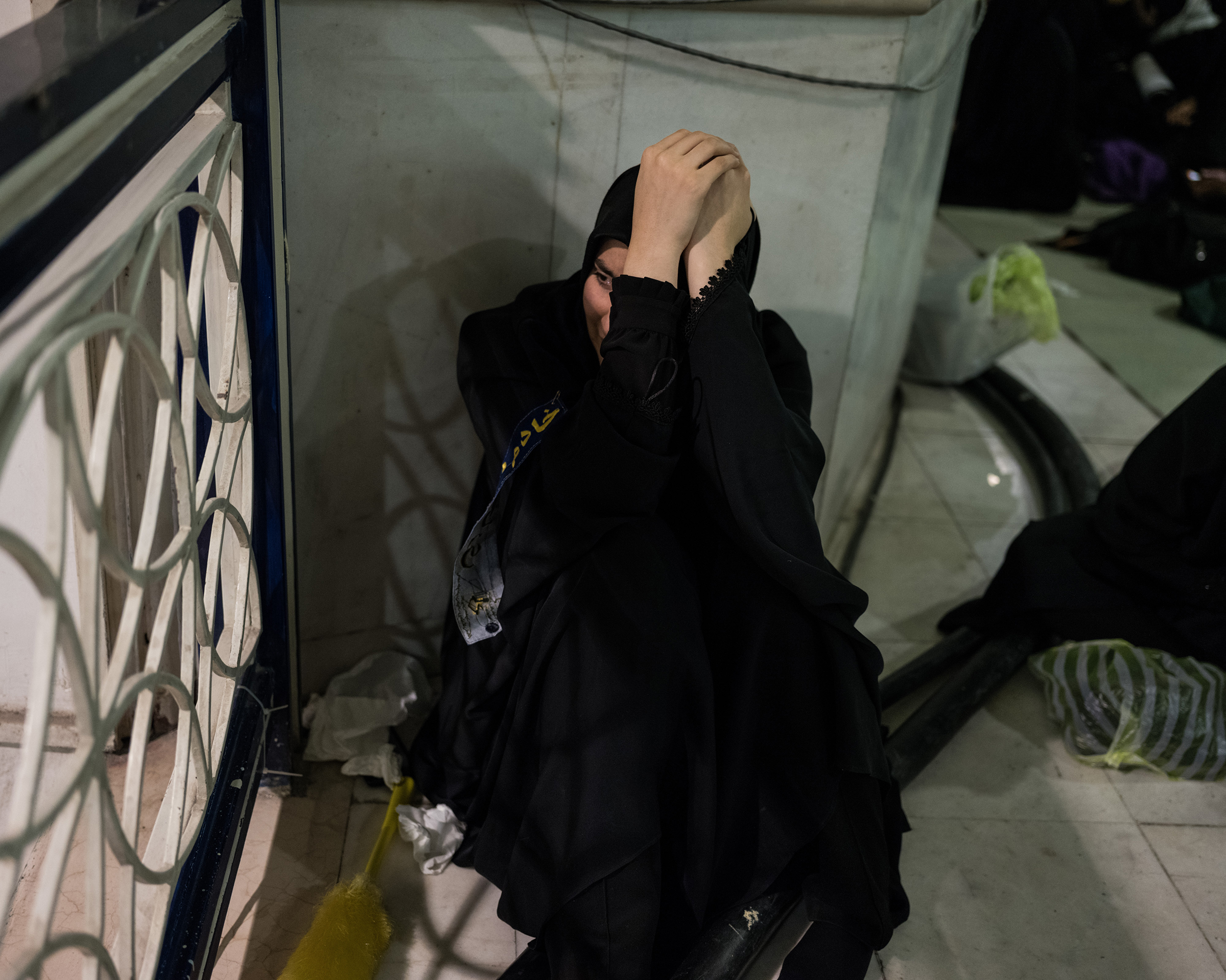 A mourner's private moment in Tehran.