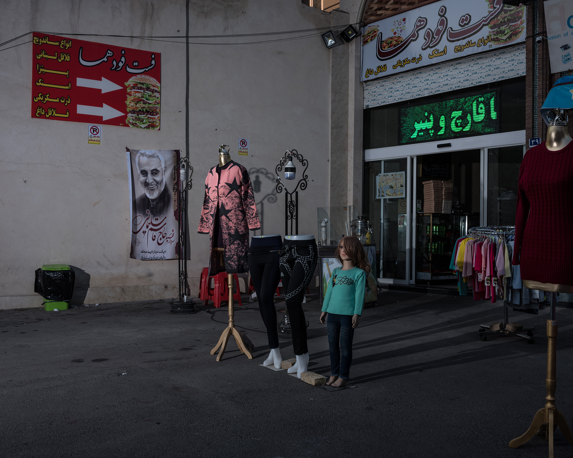 A poster of Soleimani hangs at a bazaar in the south of Tehran.