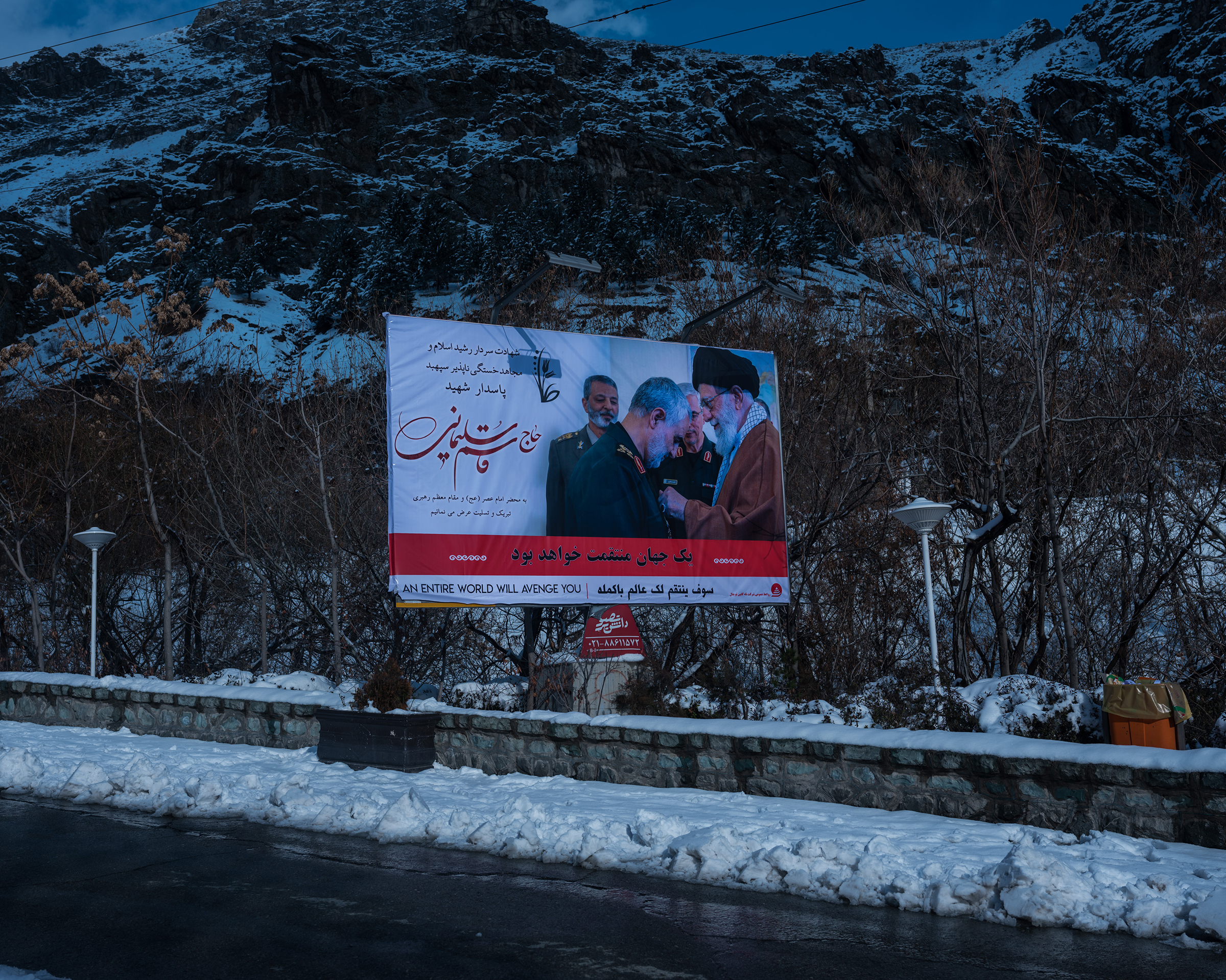 A poster showing Soleimani and the Supreme Leader, Ayatollah Ali Khamenei, in the snowy mountains above Iran's capital.