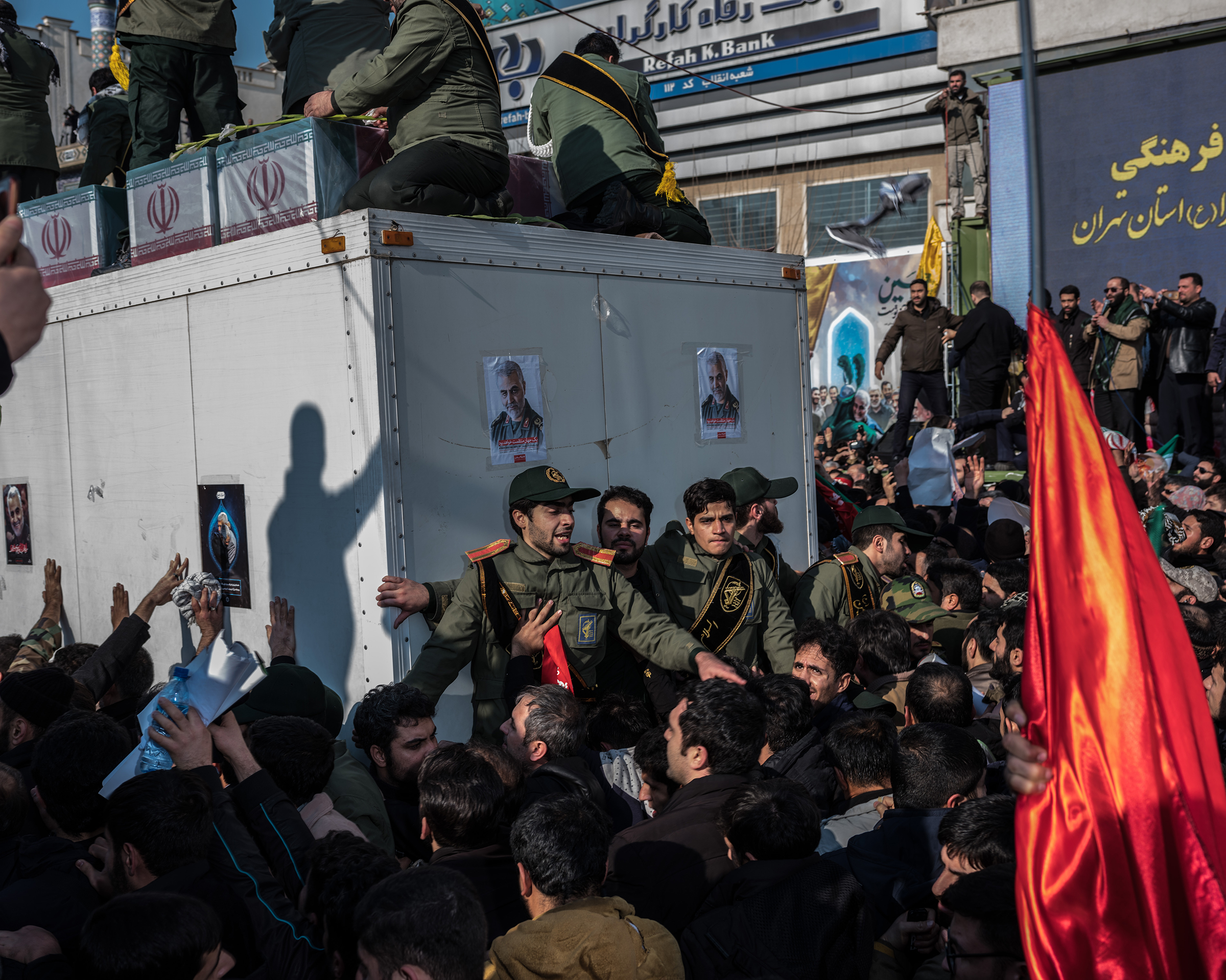 Soleimani's coffin is surrounded by throngs in Tehran's Enghelab Square on Jan. 6.