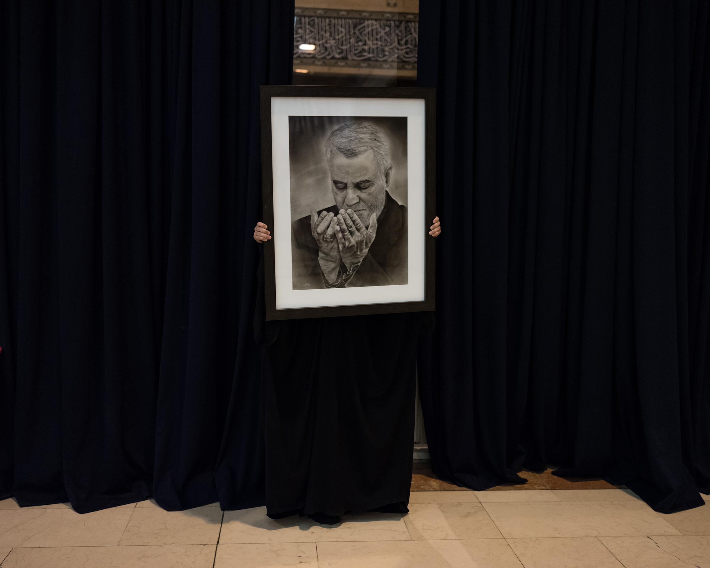 A portrait of Soleimani is held during the three official days of mourning.