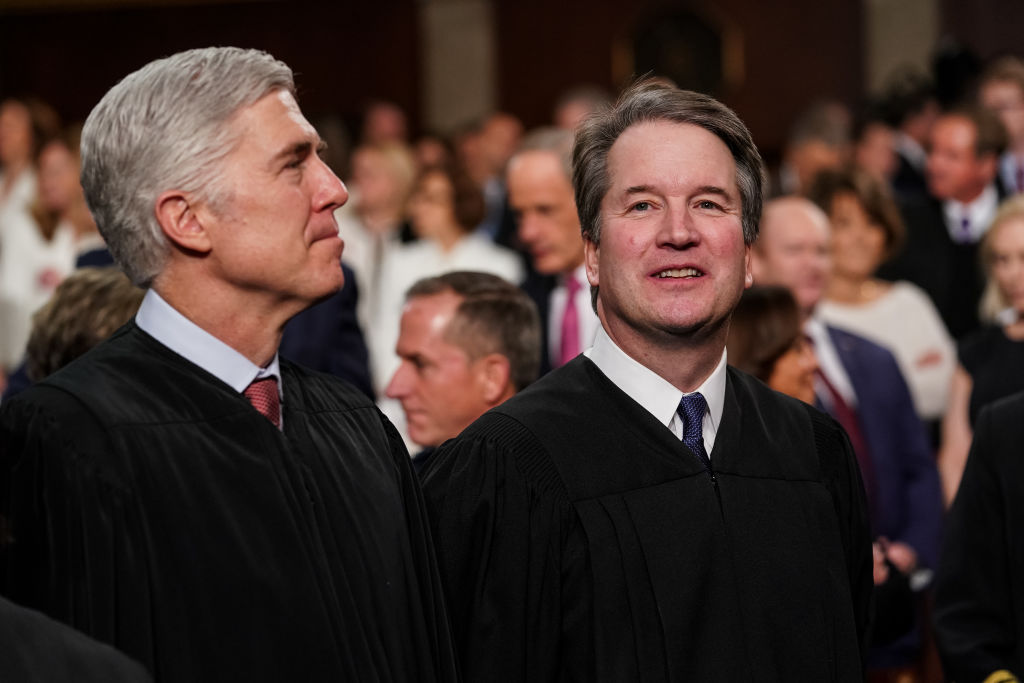 Supreme Court Justices Neil Gorsuch and Brett Kavanaugh attend the State of the Union address in the chamber of the U.S. House of Representatives at the U.S. Capitol Building on February 5, 2019.