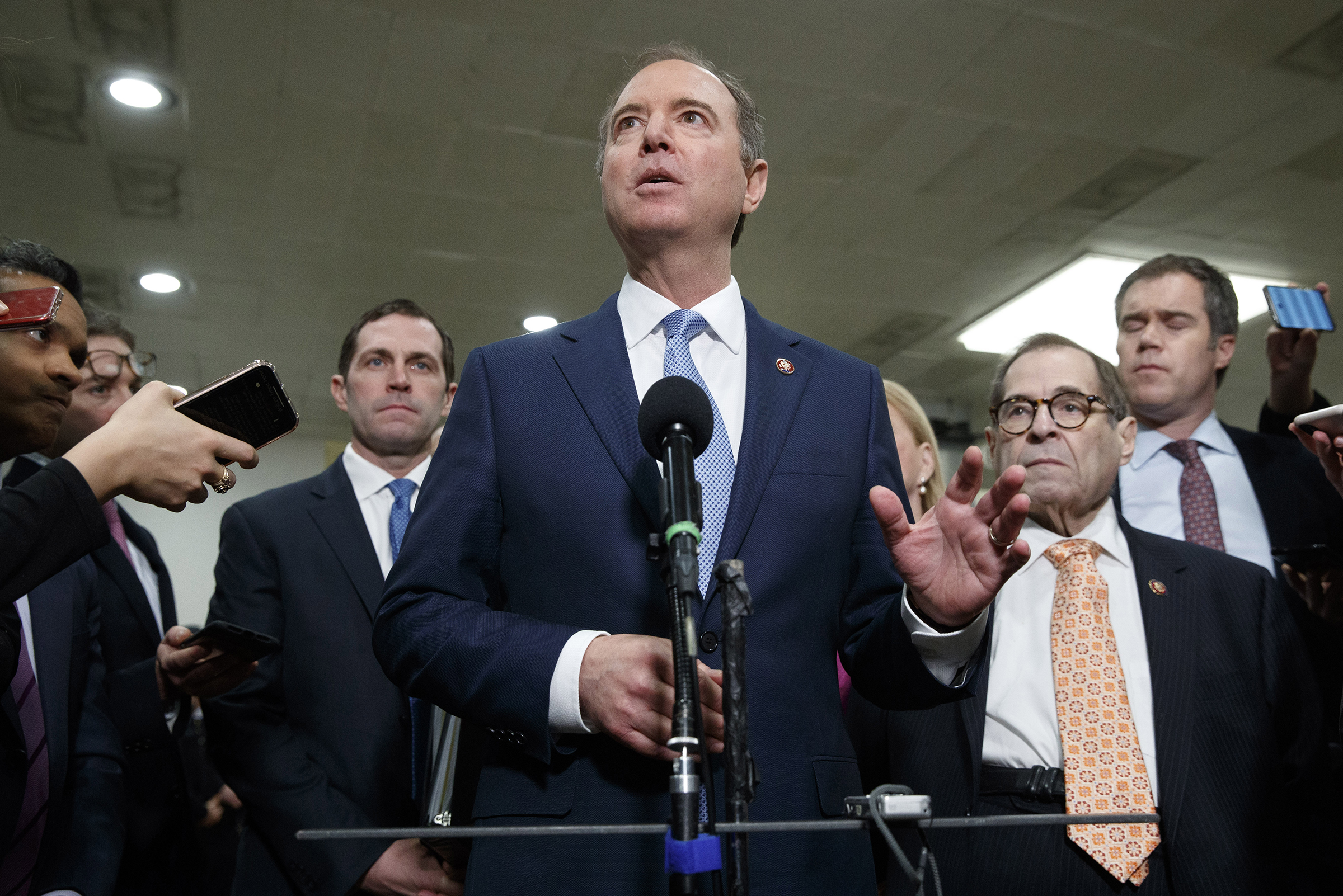 House Democratic impeachment managers including House Intelligence Committee Chairman Adam Schiff, D-Calif., center, with Rep. Jason Crow, D-Colo., left, and Judiciary Committee Chairman Jerrold Nadler, D-N.Y., speak to the media before attending the fourth day of the impeachment trial of President Donald Trump on Jan. 24, 2020 in Washington.