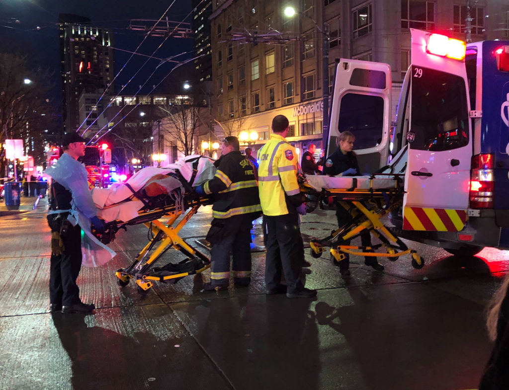 EMT and police give first aid to a shooting victim in Seattle, Wash. on Jan. 22, 2020.