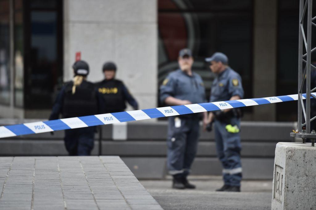 Police tape blocks a crime scene in central Stockholm, Sweden.