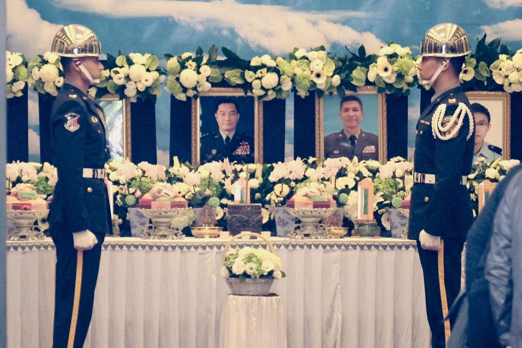 Taiwanese military guards stand in front of portraits of the victims of a fatal helicopter crash in Taiwan on Jan. 3, 2020.
